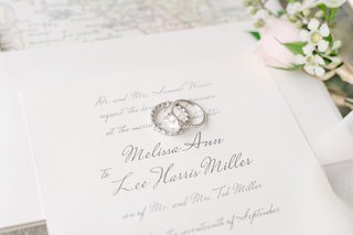 wedding-invitation-grey-calligraphy-script-with-brides-rings-eternity-band-and-solitaire-engagement