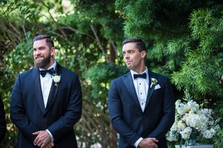 groom-and-best-man-tearing-up-as-bride-walks-down-the-aisle-groom-in-navy-suit