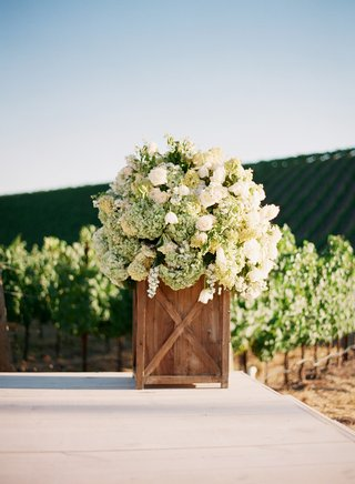 wood-box-filled-with-white-and-green-flowers