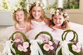 flower-girls-in-pink-dresses-flower-crowns-moss-purse-baskets