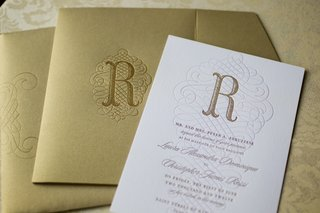 white-wedding-invitation-stamped-with-the-letter-r-and-wavy-design-gilt-envelopes