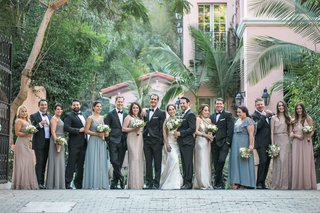 bride-and-groom-with-bridesmaids-groomsmen-mismatched-dresses-tuxedos-hotel-bel-air