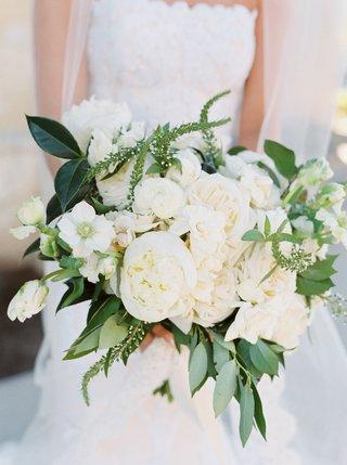 bride-holding-bouquet-of-fresh-greenery-white-peony-and-rose-flowers-romona-keveza-wedding-dress