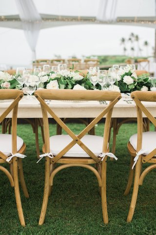 wedding-reception-montage-kapalua-bay-lawn-wood-vineyard-chair-cushion-green-garland-on-table-low