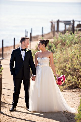 groom-in-tuxedo-and-bride-in-monique-lhuillier-wedding-dress-at-terranea-resort