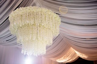 draped-ceiling-with-white-flower-chandelier-three-layer-tier-tent-wedding-ideas