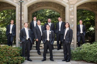 groom-and-groomsmen-in-dark-grey-suits-with-white-ties