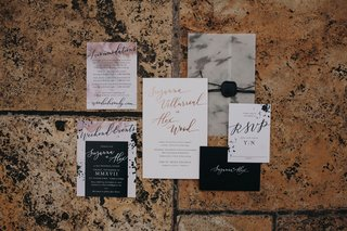 marble-and-watercolor-details-on-invitation-suite-brush-lettering-rose-gold-black-envelope-wax-seal