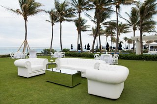 white-lounge-furniture-for-outdoor-lounge-area-at-wedding-in-palm-beach-with-palm-treees