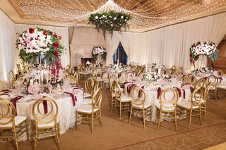 indoor-reception-space-ivory-red-blush-gold-hues-floral-chandelier-pelican-hill-ball-room-wedding