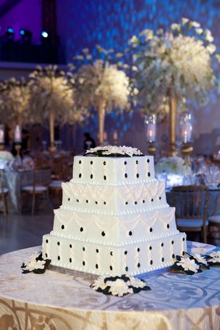 white-wedding-cake-decorated-with-dark-green-jewels
