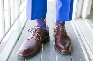 grooms-brown-shoes-with-blue-pants-and-silly-socks