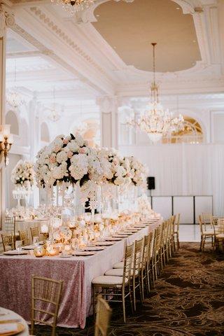 reception-ballroom-pink-linen-tall-centerpiece-pink-rose-white-hydrangea-gold-chair-candles