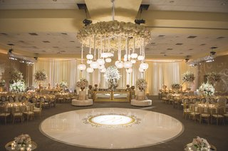 wedding-reception-with-white-dance-floor-gold-monogram-flower-chandelier-with-lanterns