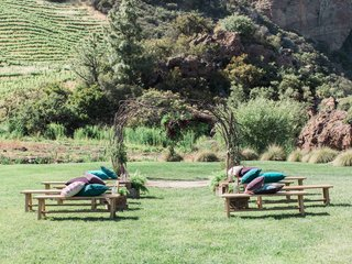 rustic-chic-outdoor-ceremony-california-boho-chic-wedding-styled-shoot-benches-pillows-vineyard-ca