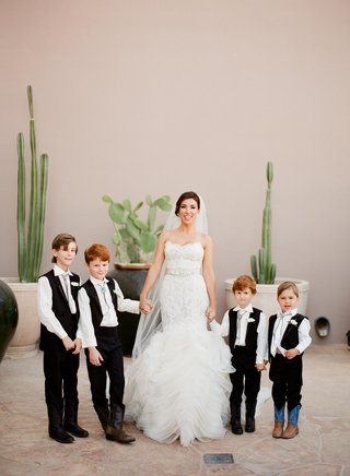 adrianna-costa-with-four-ring-bearers-in-bolo-ties