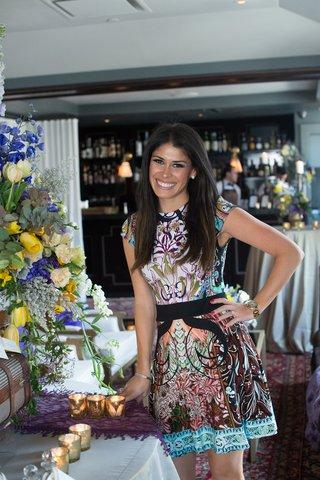 bride-posing-bridal-shower-colorful-dress-new-york-city-wedding-pre-party-bright-decor-inspiration