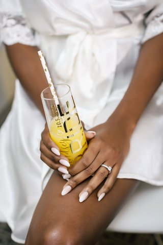 bride-with-soft-manicure-white-french-sheer-bride-champagne-flute-straw-and-engagement-ring