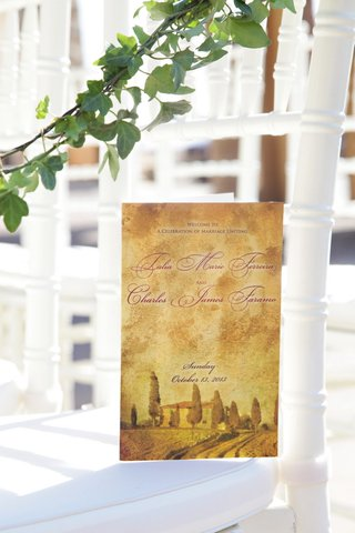 antique-style-ceremony-booklet-with-photo-of-venue