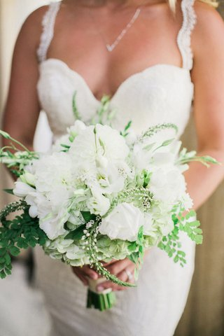 bride-in-galia-lahav-holding-bridal-bouquet-with-white-flowers-and-greenery