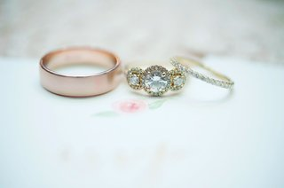 wedding-ring-rose-gold-mens-band-and-pave-yellow-gold-womens-band-with-three-stone-engagement-ring