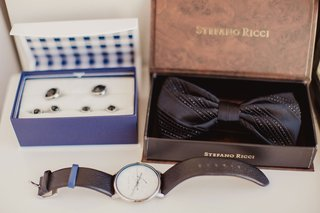 wedding-groom-getting-ready-accessories-cuff-links-in-navy-box-bow-tie-stripe-metallic-and-watch