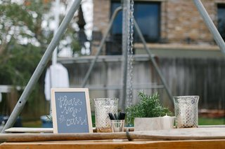 chalkboard-sign-at-guest-book-table-with-wooden-oars-to-sign