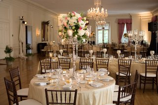 ivory-reception-tables-with-candlestick-centerpieces-and-chandeliers