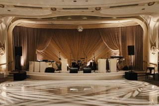 wedding-reception-dance-floor-light-projections-drapery-band-stage-ballroom-beverly-hills
