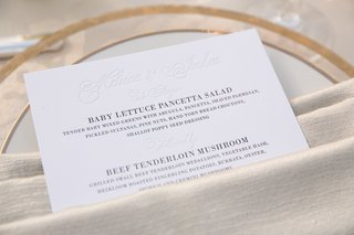 wedding-menu-card-tucked-into-neutral-napkin
