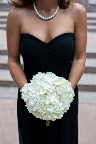 woman-in-black-gown-holding-white-hydrangeas