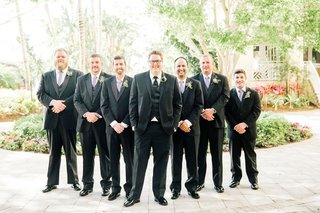 groom-in-three-piece-suit-with-circle-boutonniere-groomsmen-in-suits-with-lavender-purple-ties