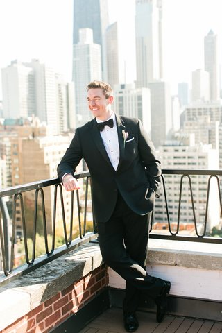 groom-in-tuxedo-jacket-bow-tie-with-chicago-skyline-in-background