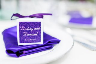 purple-napkin-and-favor-on-white-plate