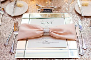 pink-bow-napkin-tied-with-crystal-ring-on-mirrored-charger