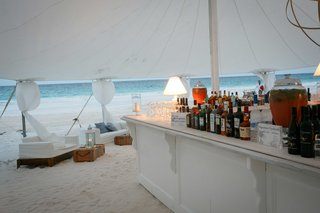 ocean-view-tent-wedding-white-bar-with-white-lounge-furniture-on-sand-beach-in-the-bahamas