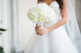 white-manicure-on-bride-holding-white-rose-ranunculus-and-peony-flowers-in-white-pale-pink-center