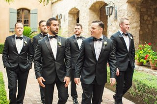 groom-in-tuxedo-and-white-boutonniere-with-groomsmen-in-rose-boutonnieres-at-silverleaf-club