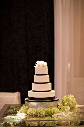 black-and-white-wedding-cake-with-white-tiers-black-ribbon-details-and-white-cake-topper