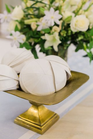 wedding-ceremony-jewish-wedding-entry-table-yarmulkes-ivory-on-gold-footed-stand