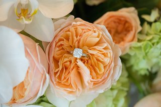 sparkling-engagement-ring-situated-in-peach-peony