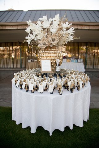 round-table-topped-with-custom-champagne-bottles