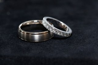 grooms-brushed-wedding-ring-with-polish-edges-brides-diamond-wedding-ring