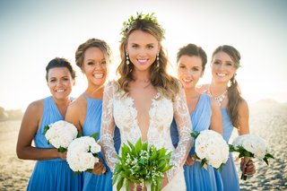 bride-bridesmaids-triangle-pose-spacing-windows-beach-blue-dresses-white-bouquets-san-diego