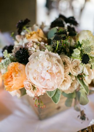 ranch-wedding-reception-table-with-wood-box-pale-pink-peach-peonies-roses-greenery