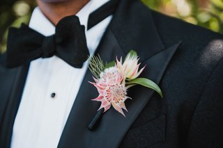 groom-boutonniere-made-with-three-blushing-bride-protea-blossoms