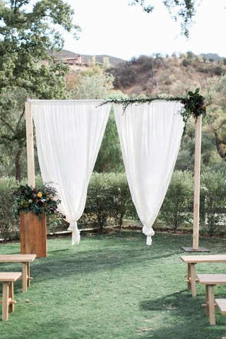 wooden-ceremony-arch-white-drapery-floral-southern-california-winter-wedding-styled-shoot-brookview