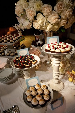desserts-on-high-and-low-stands-with-flowers-in-background