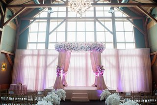 wedding-canopy-beneath-exposed-wood-beams