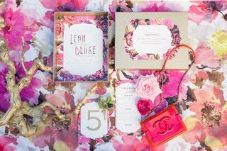 pink-floral-table-linen-white-and-pink-wedding-menu-coco-chanel-inspired-gold-branch-chanel-purse